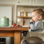 Boy in travel high chair