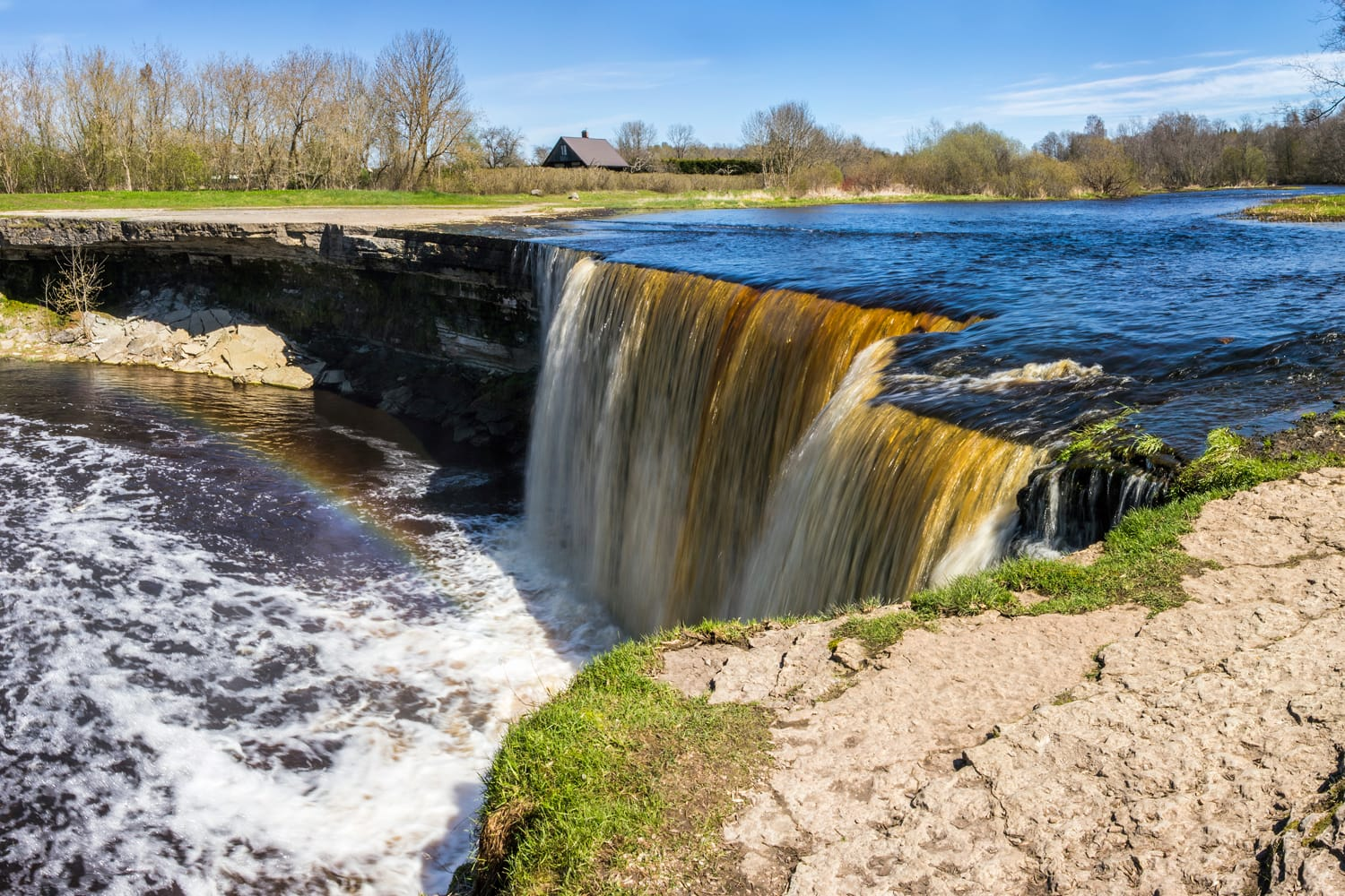 Panoramic view of the famous Jagala( Jägala) waterfall with rainbow in mist, Estonia