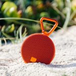 Portable bluetooth speaker on the beach