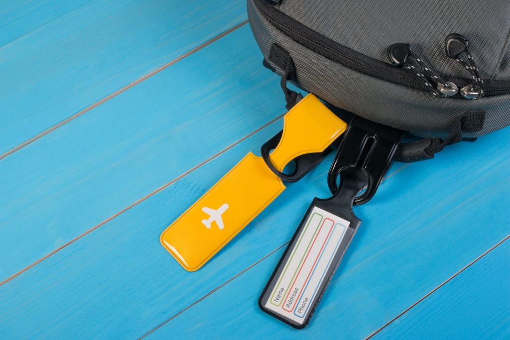 Close up of blank luggage tag label on suitcase or bag