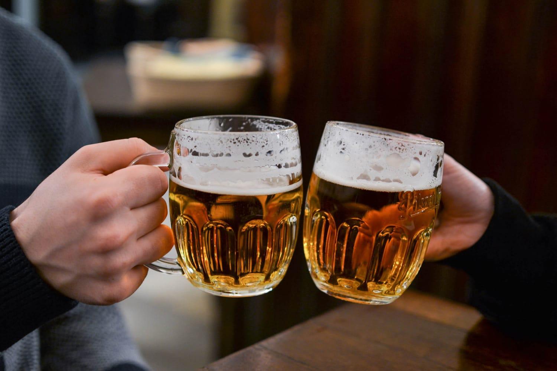 Friends having draught beer in Prague, Czechia
