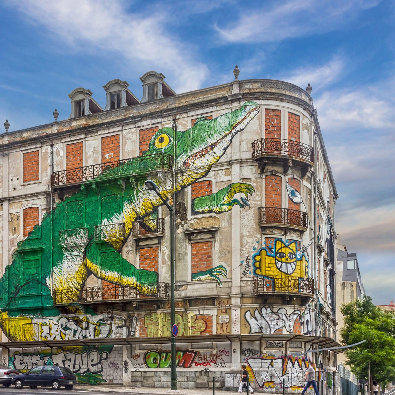 Lisbon street art. graffiti green crocodile. Painting house, Avenida Fontes Pereira de Melo, Lisboa, Portugal.