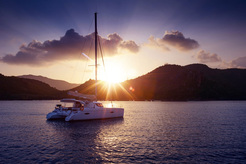 Sunset with catamaran in Santorini, Greece