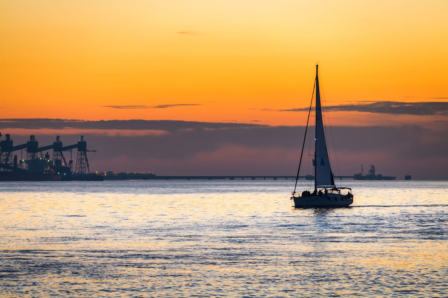 Luxury yacht Sailing on Tagus river at sunset in Lisbon, Portugal