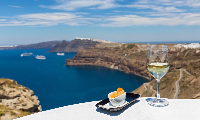 Wine glass with sea view in Santorini, Greece