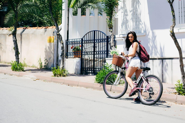 Woman on bicycle in Santorini, Greece