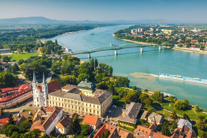 View of the Hungarian historic town from the basilica in Esztergom, the Danube river and the border bridge to the town of Sturovo in Slovakia.