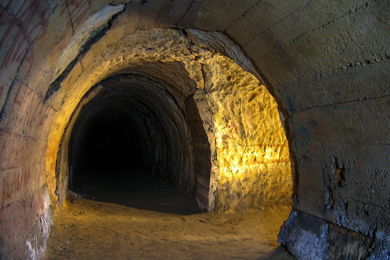 Underground corridor in sandstones with a concrete wall in the area of Divoka Sarka, Prague, Czechia