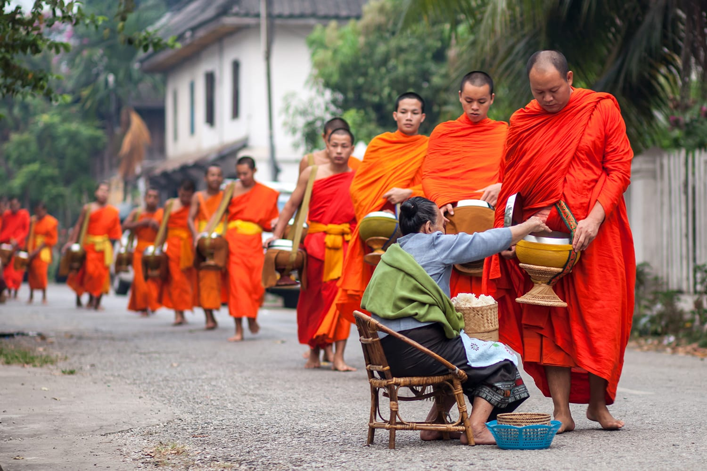 Traditional alms giving in Luang Prabang, Laos