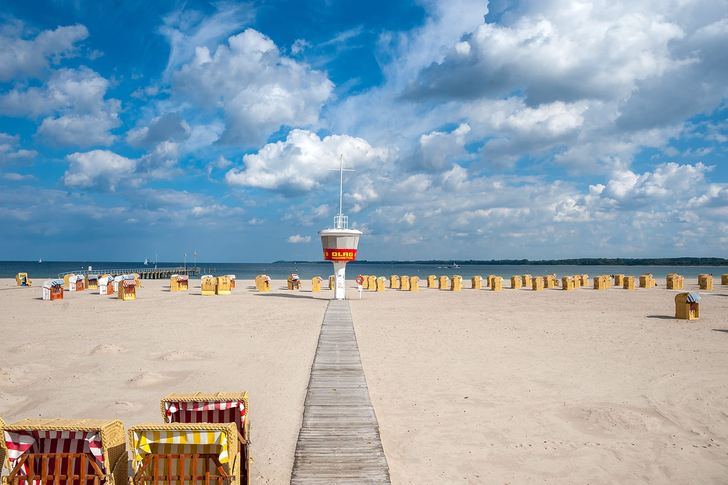 Beach with lifeguard tower of the DLRG in Travemuende at the Baltic Sea