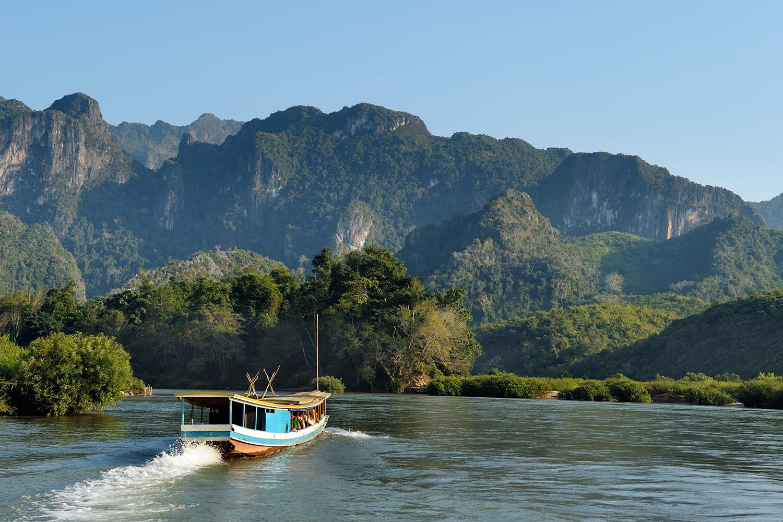Beautiful landscape with boat tour at Mekong river near Luang Prabang in Laos.