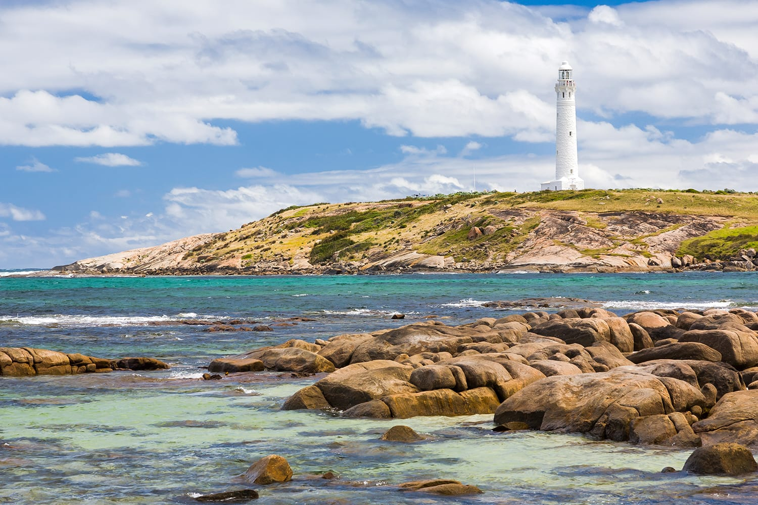Beach at Cape Leeuwin with the lighthouse in the distance, Augusta Western Australia