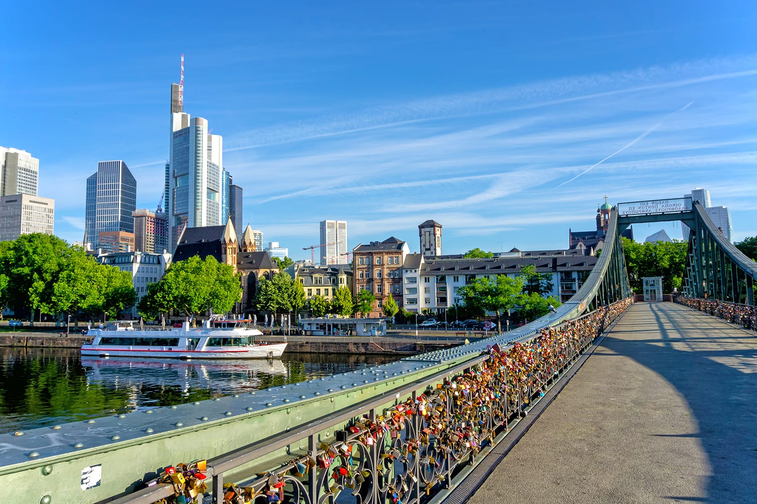 Frankfurt financial district skyline and bridge Eiserner Steg on a sunny day, Germany