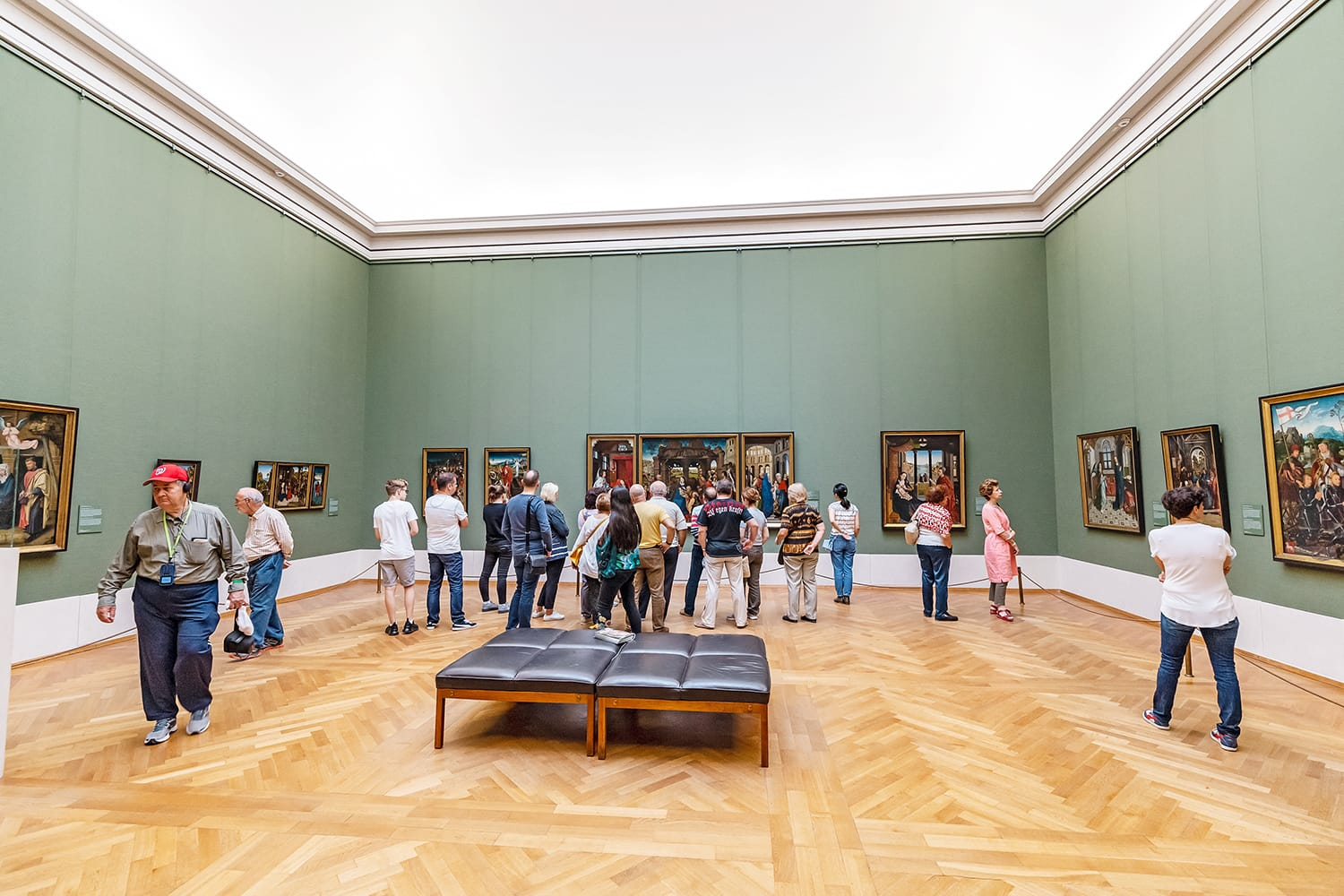 Visitors to the old Pinakothek in Munich admire the paintings of the great masters of antiquity