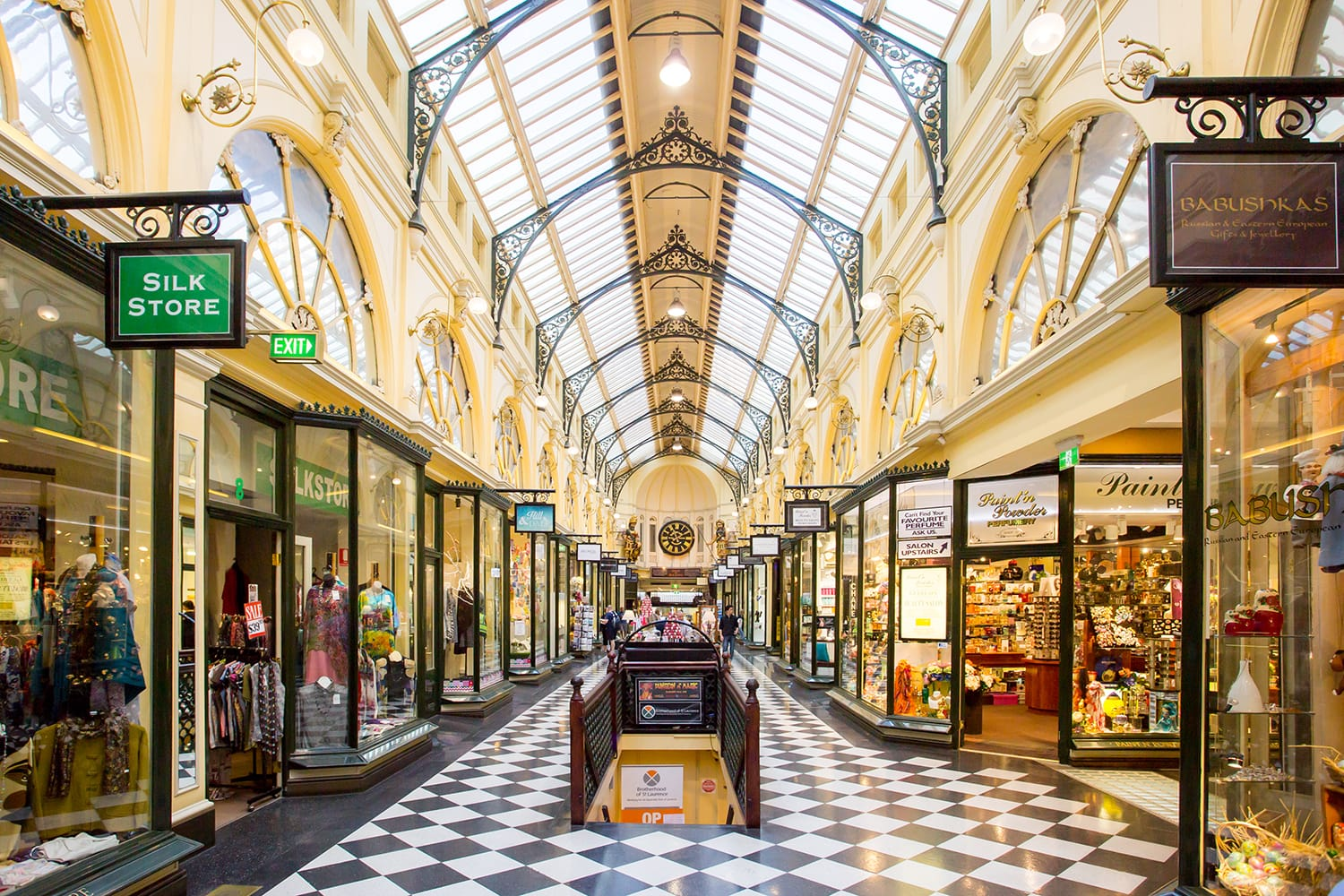 Melbourne's famous Royal Arcade shopping centre during the day with shoppers.