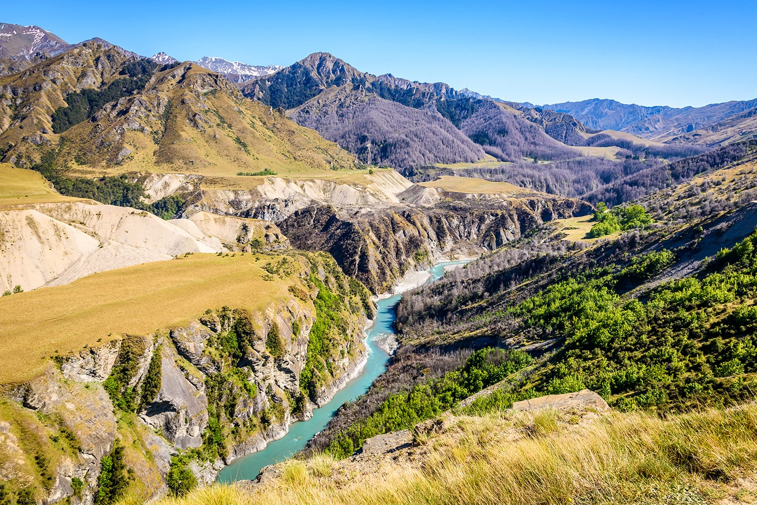 Looking up the valley of the Shotover river in Skippers canyon on a beautiful sunny day, near Queenstown, South Island, New Zealand