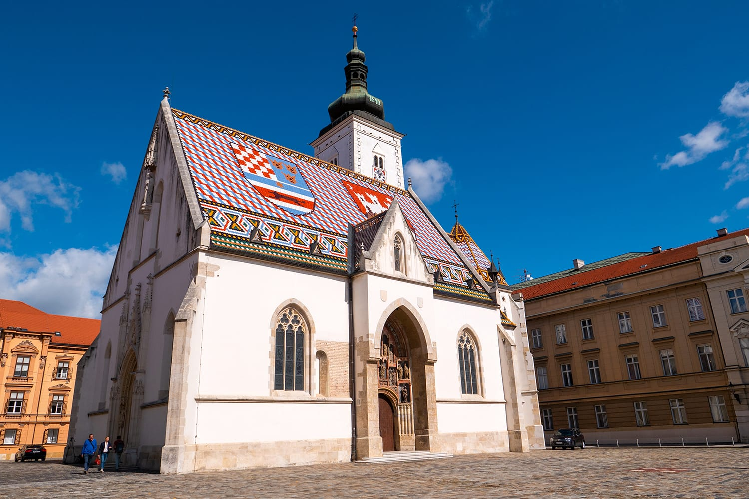 Tourists visits St. Mark's Church in Zagreb, Croatia