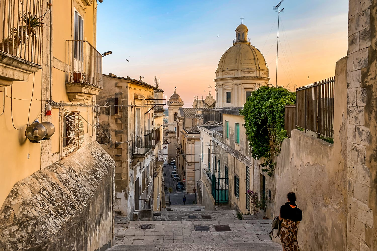 View of beautiful and typical streets and stairs in the baroque town of Noto in the province of Syracuse in Sicily, Italy