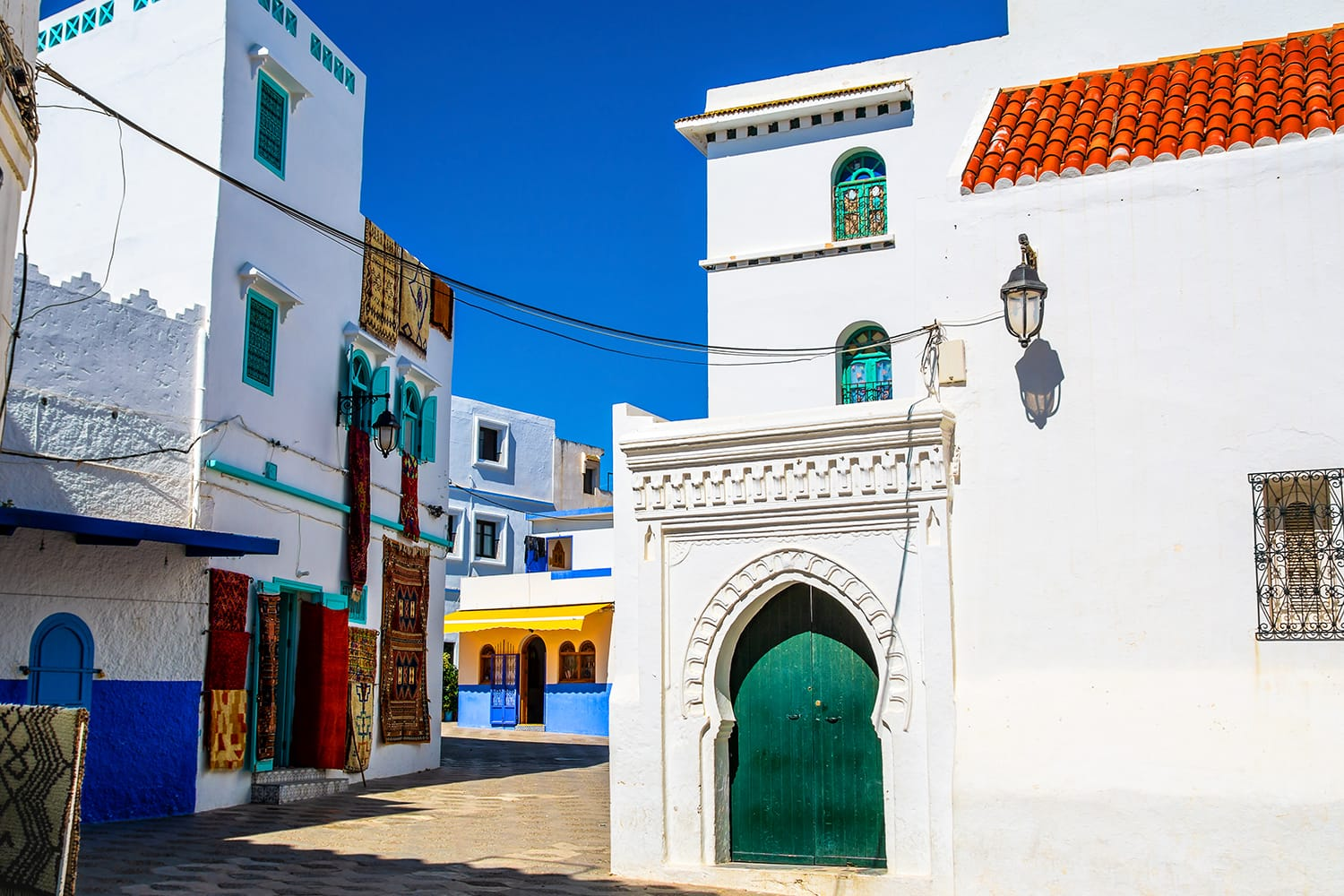 Beautiful view of street with typical arabic architecture in Asilah, North Morocco, Africa.