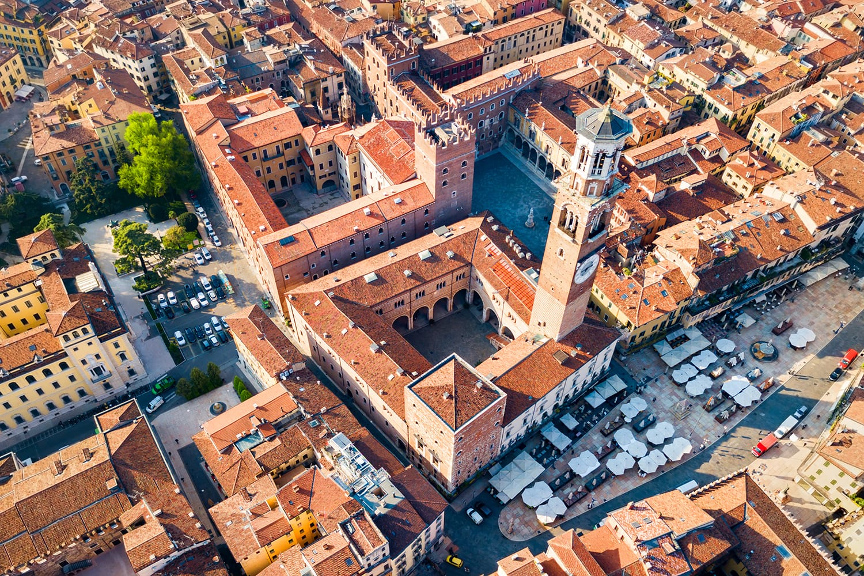 Torre dei Lamberti aerial panoramic view. Torre Lamberti is tower in Piazza delle Erbe square in Verona, Veneto region in Italy.