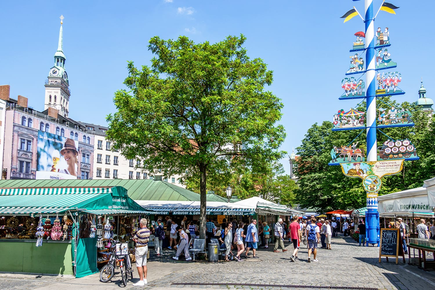 View of Viktualienmarkt a sunny day. It is a daily food market and a square in the center of Munich near Marienplatz