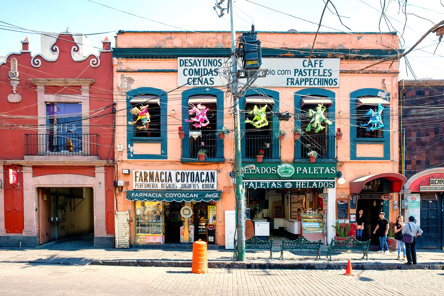 Local businesses at a colorful colonial building in Coyoacan, a historic neighborhhod in Mexico City