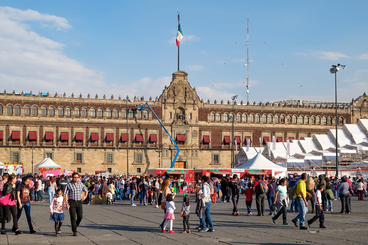 People at El Zocalo in Mexico City with the National Palace