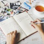 Writing in travel journal
