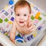 Baby playing in Playard
