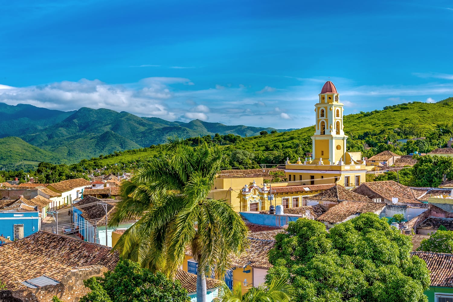 Trinidad de Cuba, panoramic skyline with mountains and colonial houses.