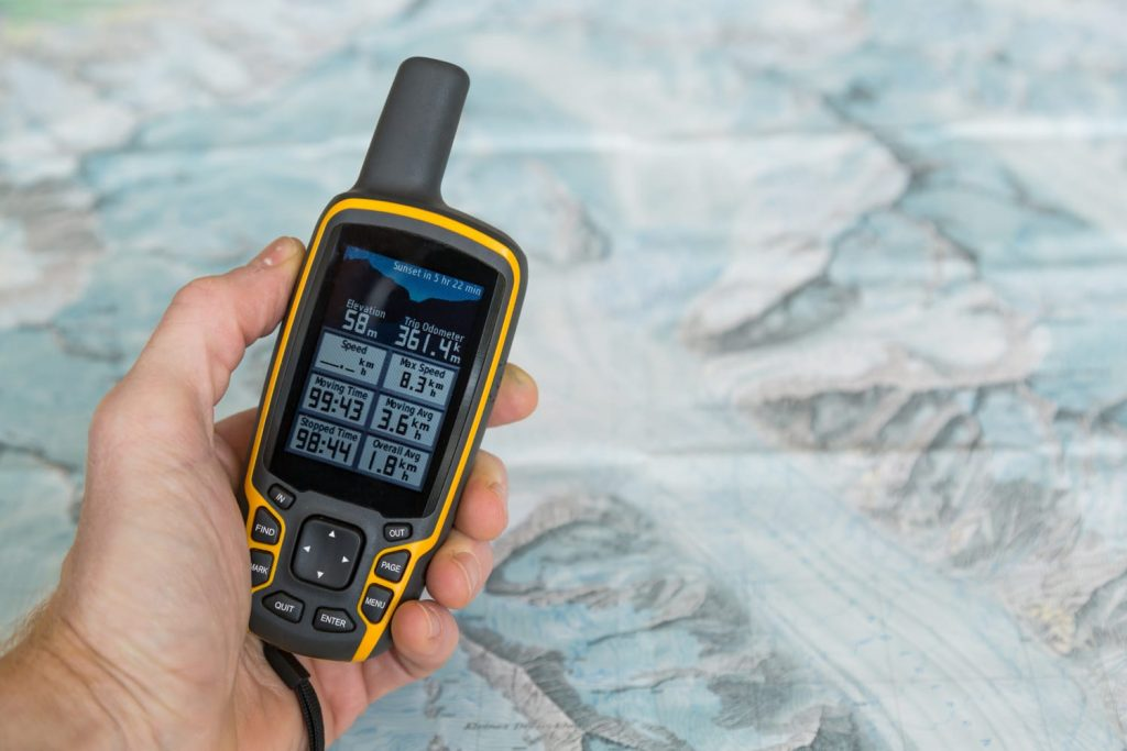 Handheld outdoor GPS and a hiking map