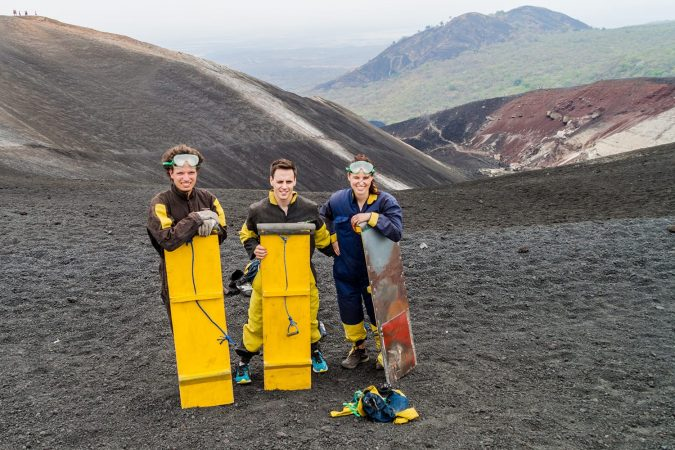 Tourists are ready for volcano boarding from Cerro Negro volcano, Nicaragua