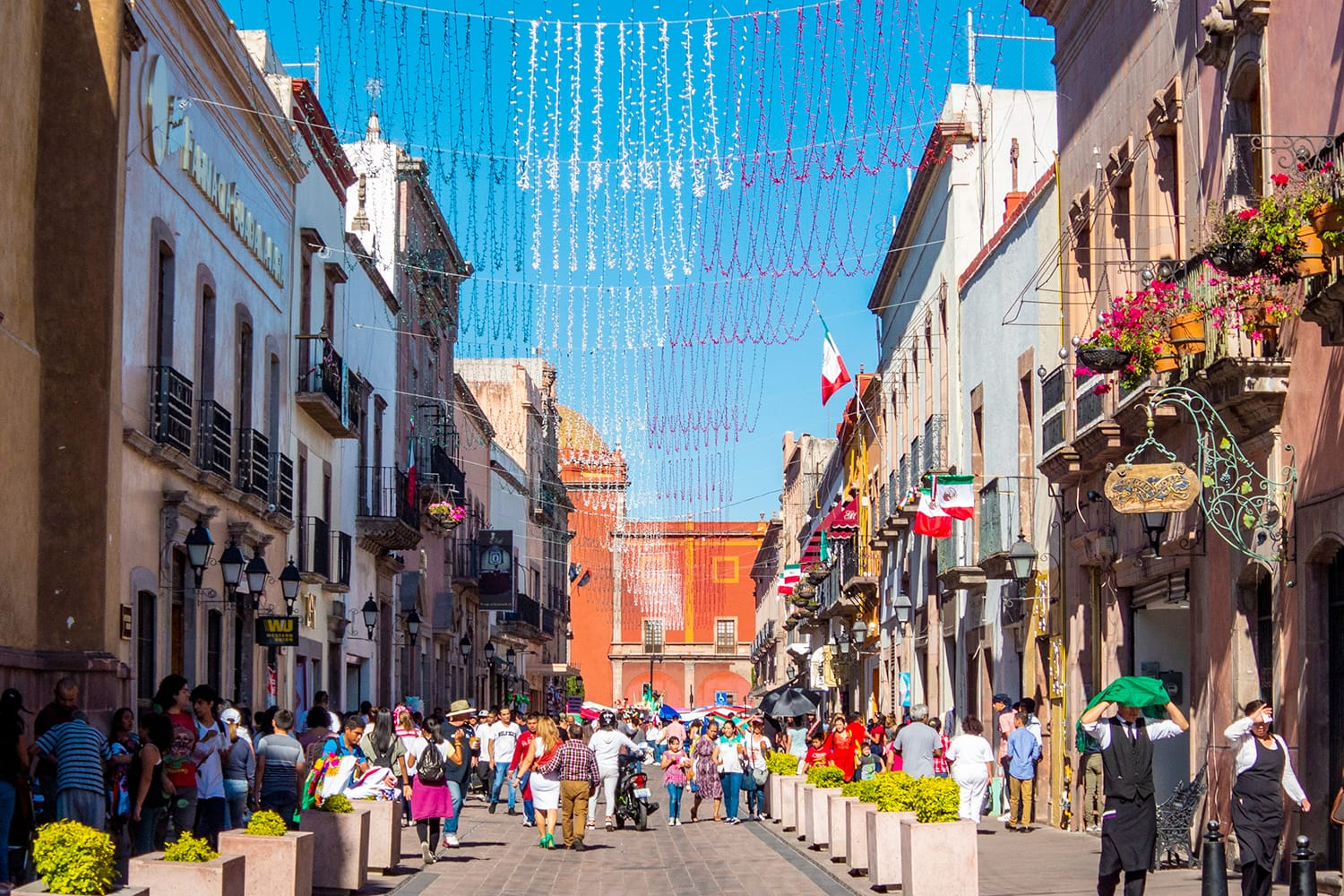 A crowd in Calle Francisco I Madero enjoying the celebration of Independence Day in Queretaro, Mexico.