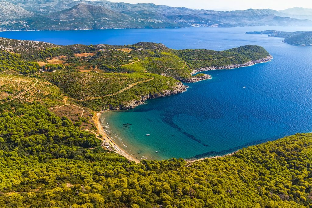 Sandy beach on Elaphites island Lopud with a view to the Dubrovnik archipelago.