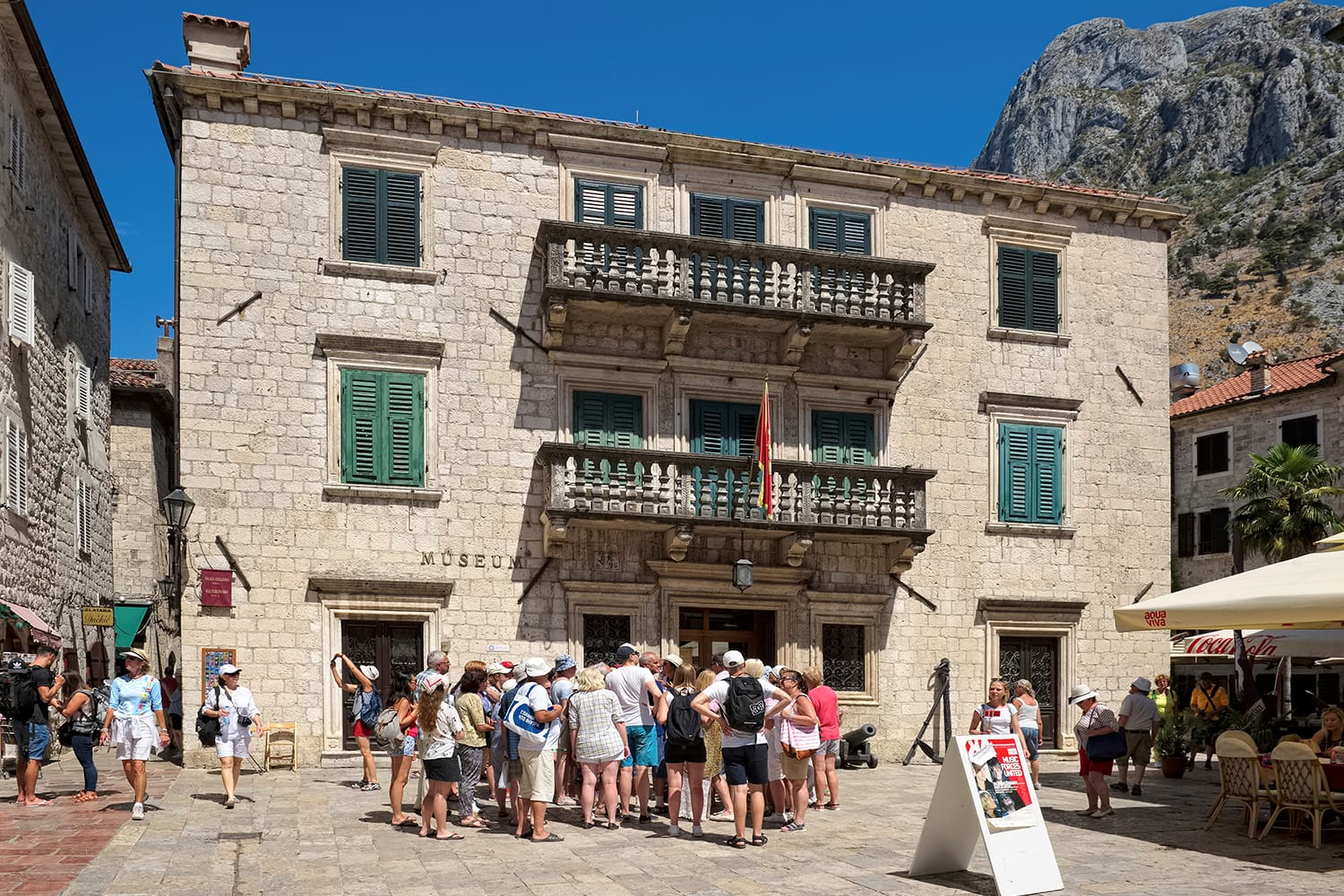 Tourists near the Maritime Museum located in the Grgurina Palace, Kotor, Montenegro