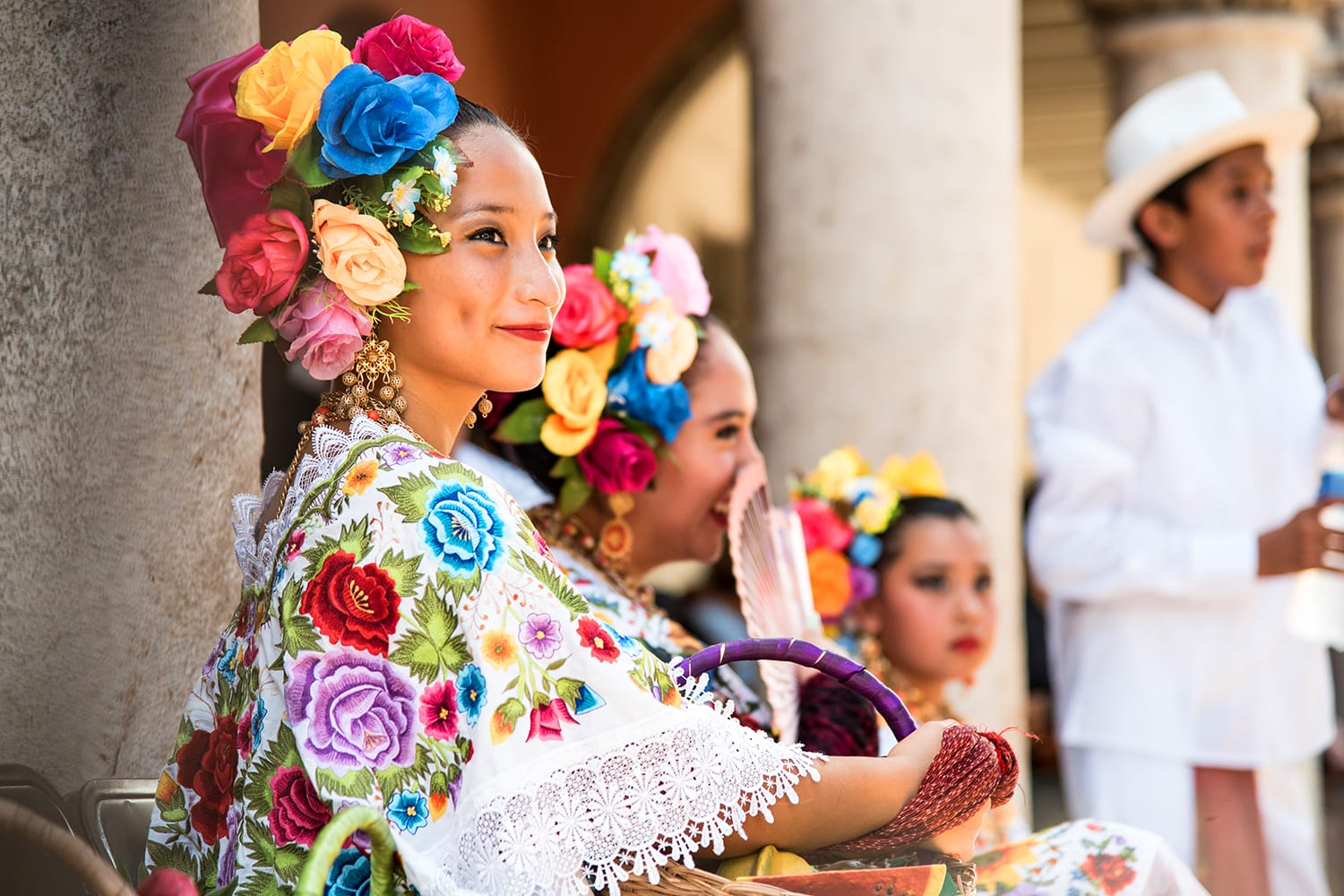A picture of a young mayan dancer, member of the folkloric ballet of the state of Yucatán. Wearing the typical Yucatán costume