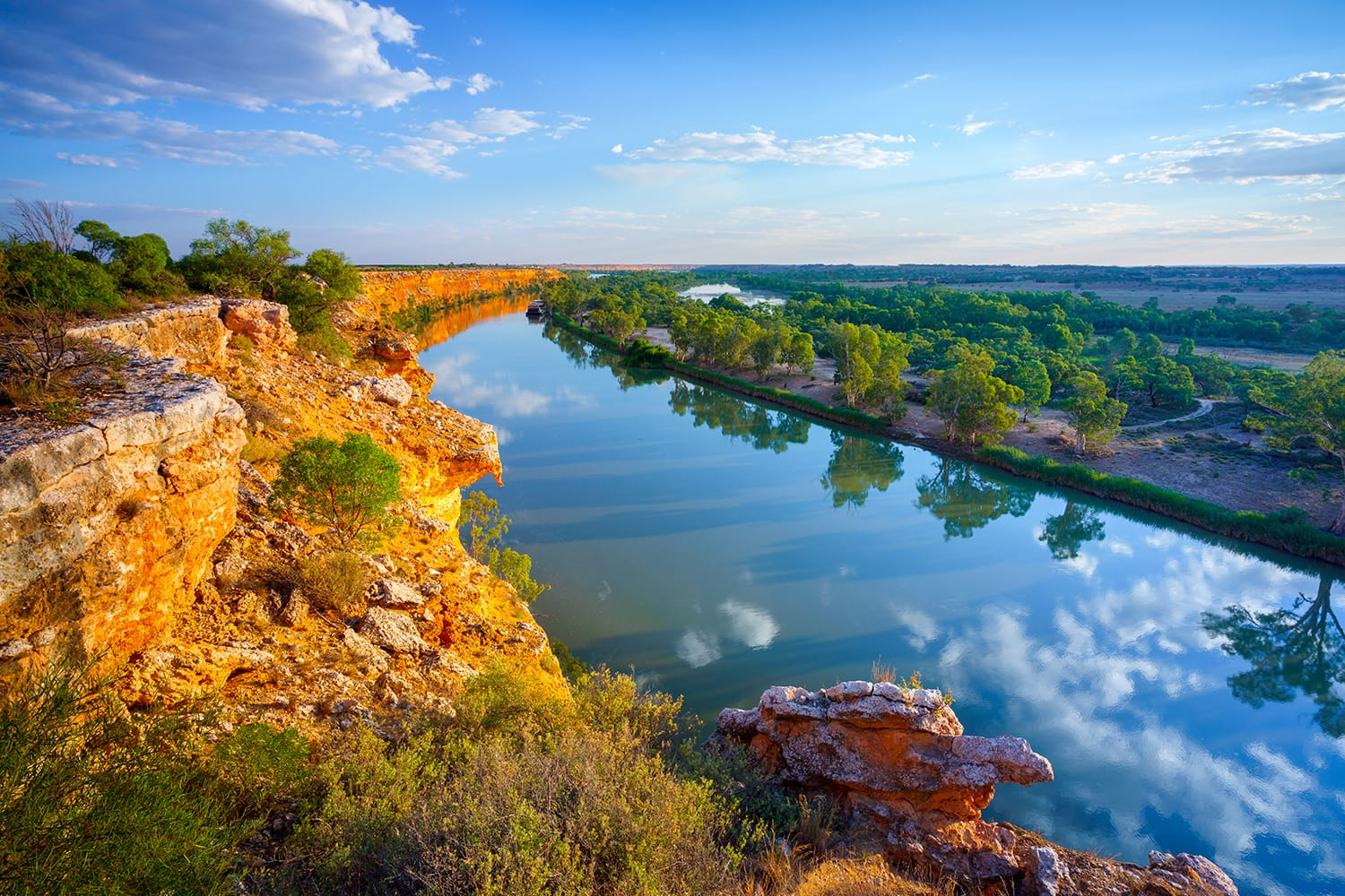 Golden glow on cliffs on the Murray River, South Australia
