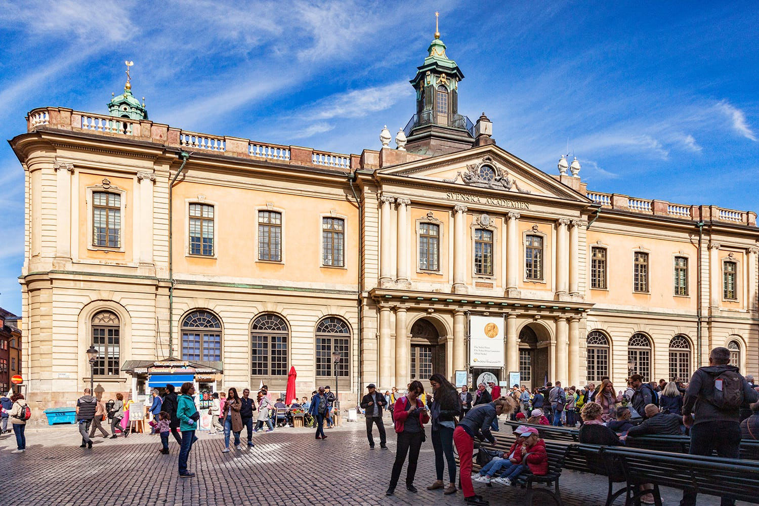 Tourists outside the Nobel Museum in Stockholm, Sweden