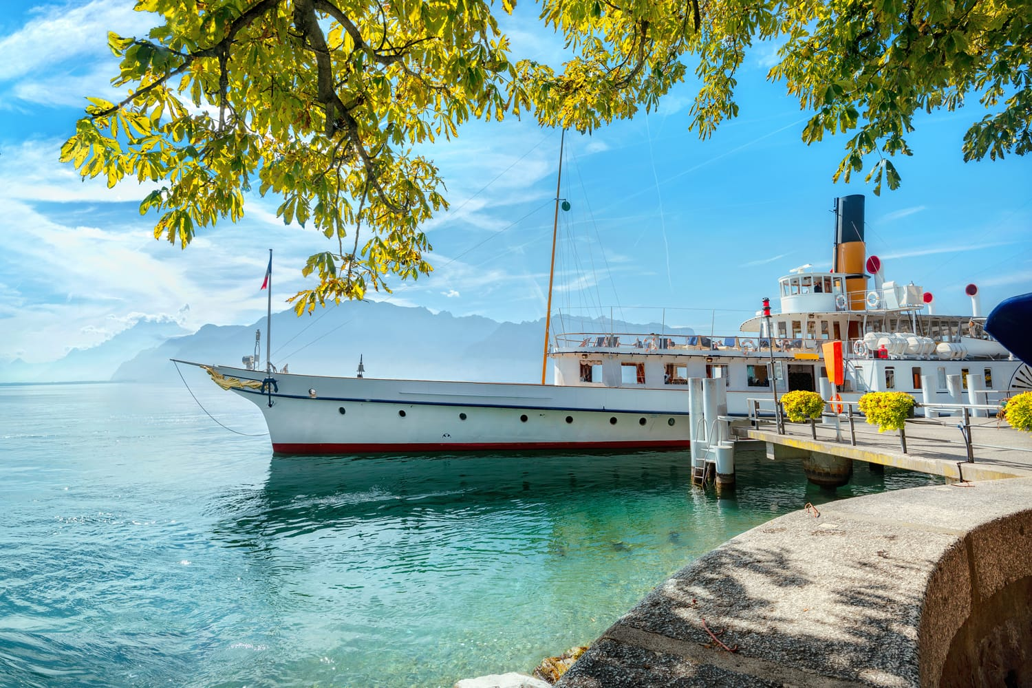 Panoramic view of Geneva Lake with touristic old ferry in Vevey town. Vaud canton, Switzerland