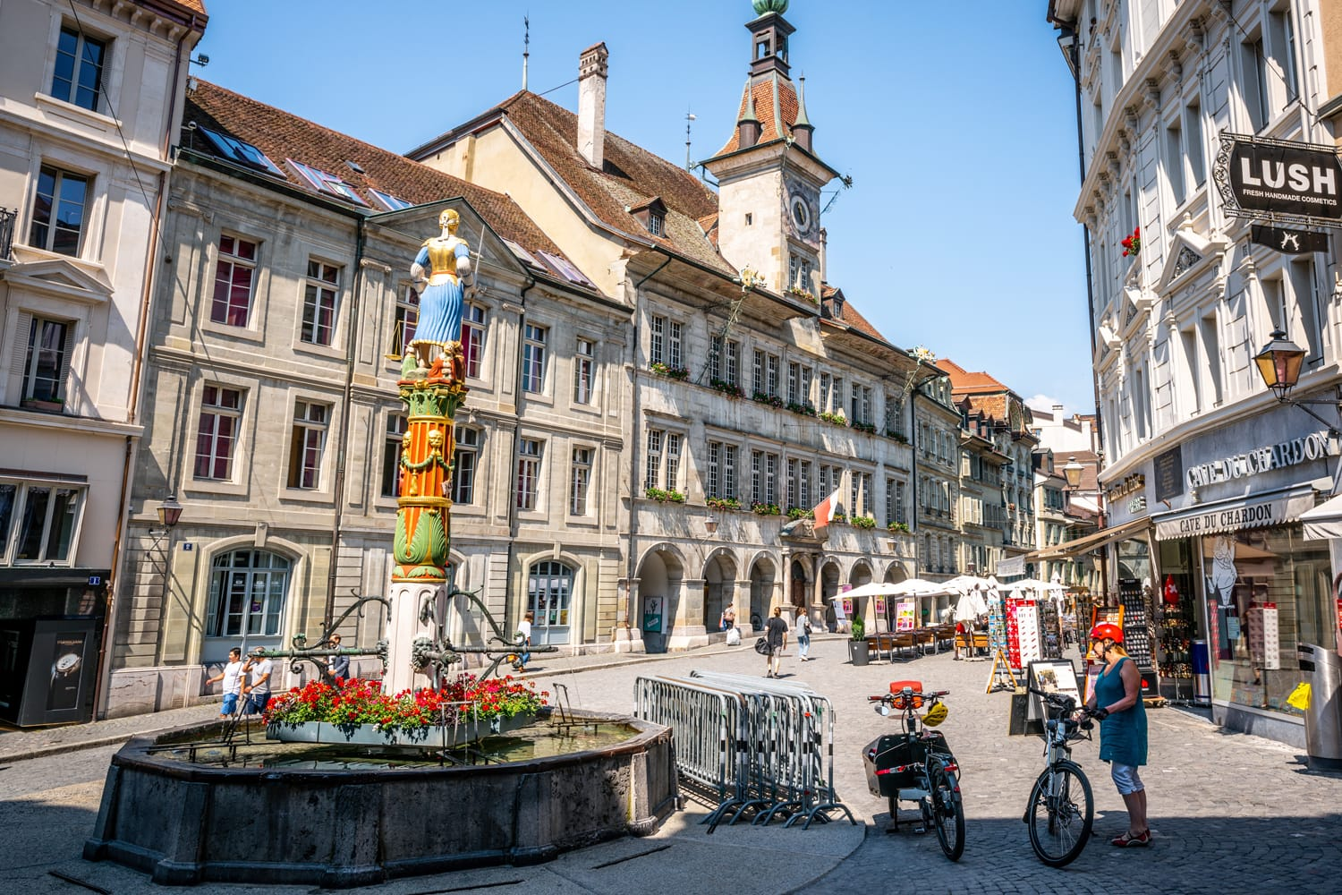 Place de la Palud or Palud square with the iconic Justice fountain and the Lausanne city hall in Lausanne Switzerland