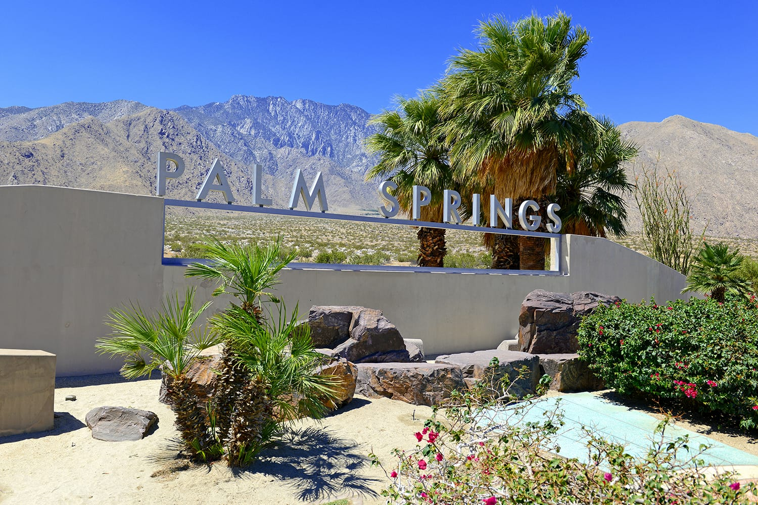 Palm Springs sign with desert background and backdrop of San Jacinto Mountain, California, USA