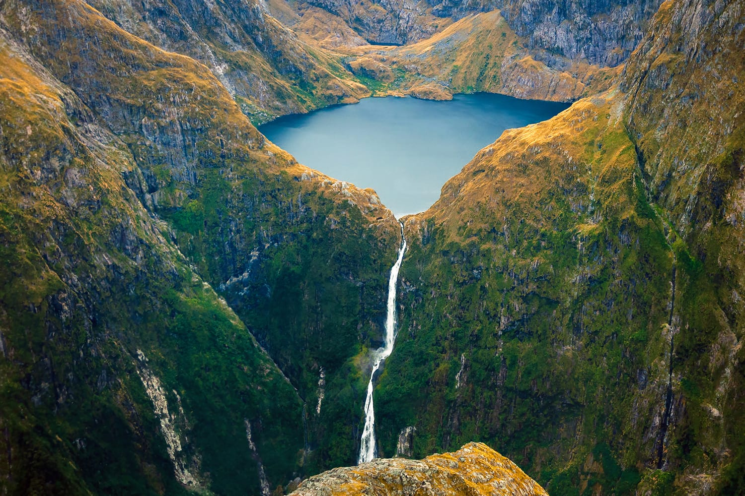 Amazing aerial view of mountain Lake Quill and Sutherland Falls on the scenic flight from Milford Sound to Queenstown, Fiordland, New Zealand