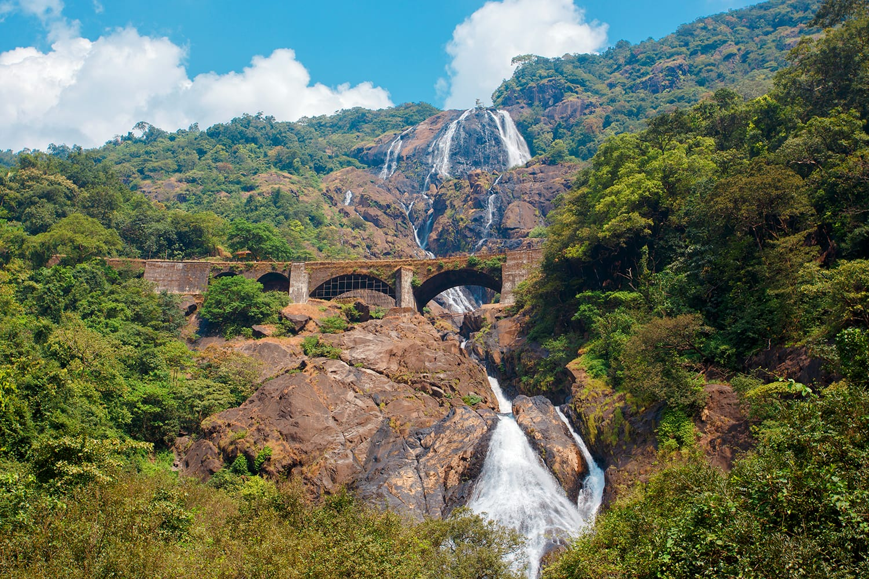 Beautiful view of the Dudhsagar waterfall and railroad bridge in Goa, India
