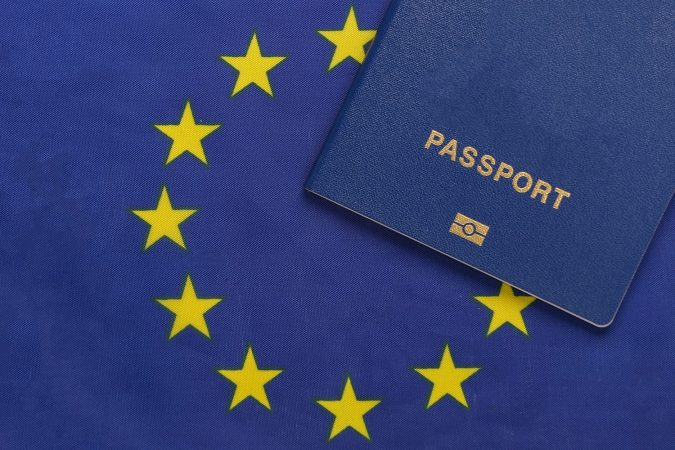 Passport against the background of European Union flag