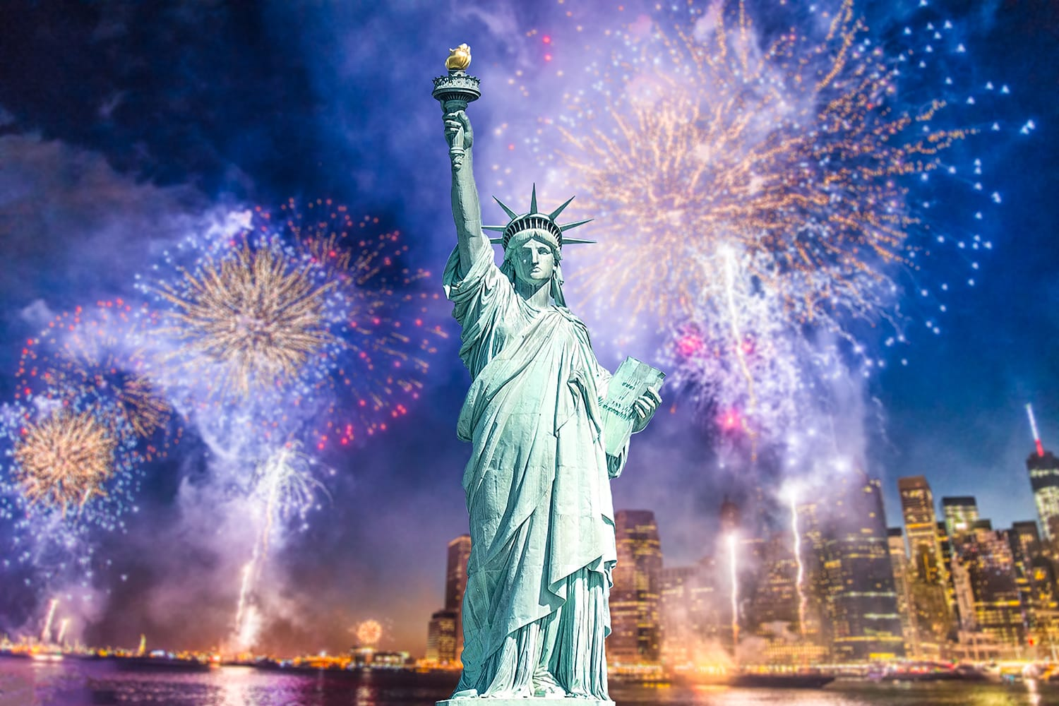 Fireworks on New Years Eve in front of Statue of Liberty in NYC, USA