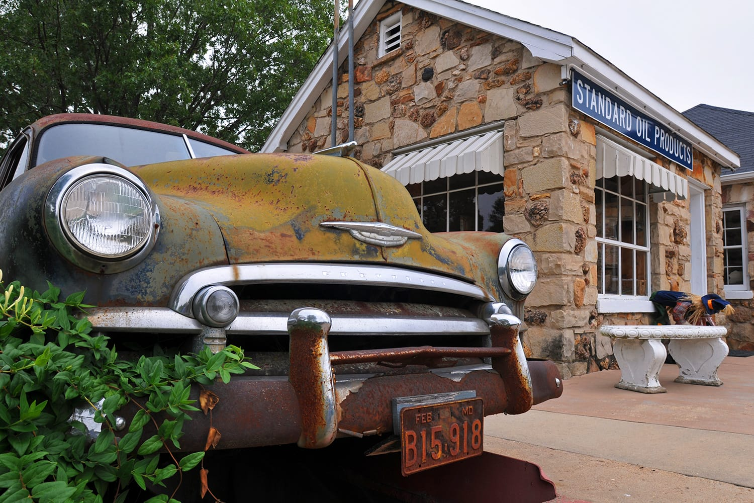 An old Chevrolet automobile sits near the former service station at the Wagon Wheel Motel, a historic landmark on Route 66 in Cuba, Missouri, USA