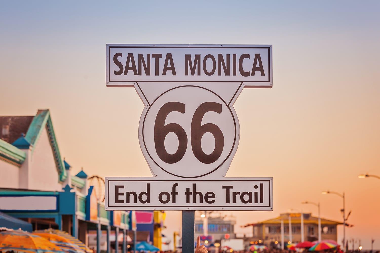 Historic Route 66 sign on pierce of Santa Monica, California