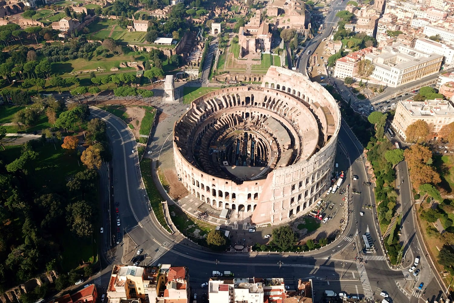 Aerial drone view of iconic and beautiful ancient Arena of Colosseum, also known as the Flavian amphitheatre in the heart of Rome, Italy