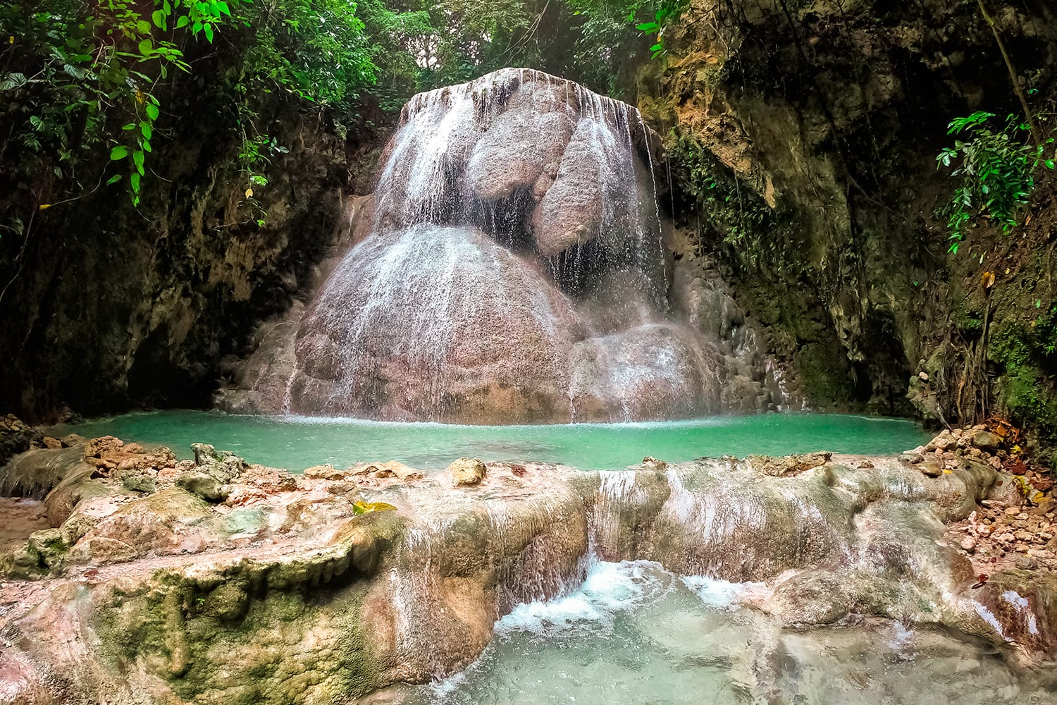 Aguinid waterfall in a mountain gorge in the tropical jungle of the Philippines, Cebu.
