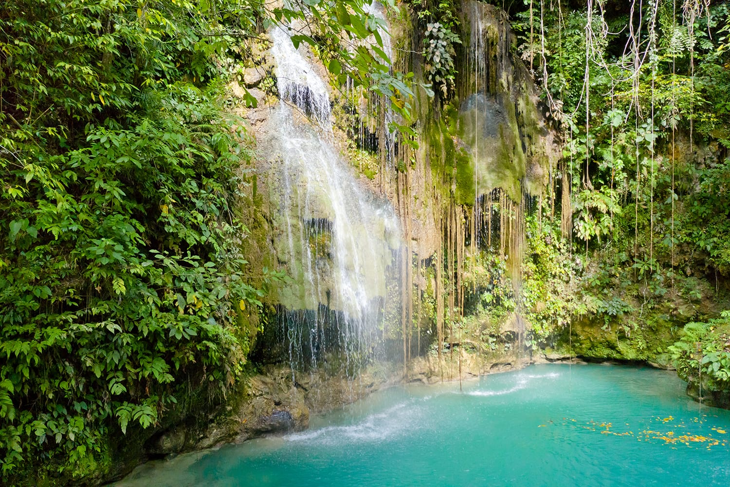 Cambais waterfalls in a mountain gorge in the tropical jungle, Philippines, Cebu